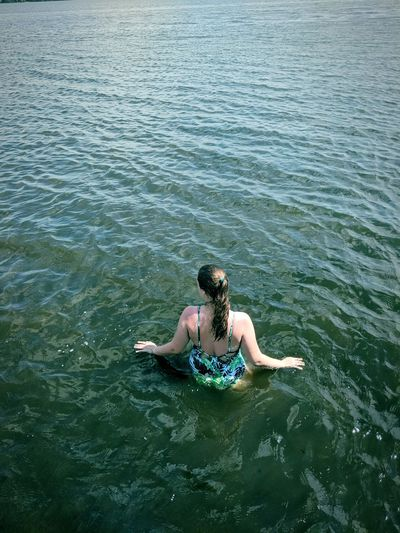 High angle view of woman in river