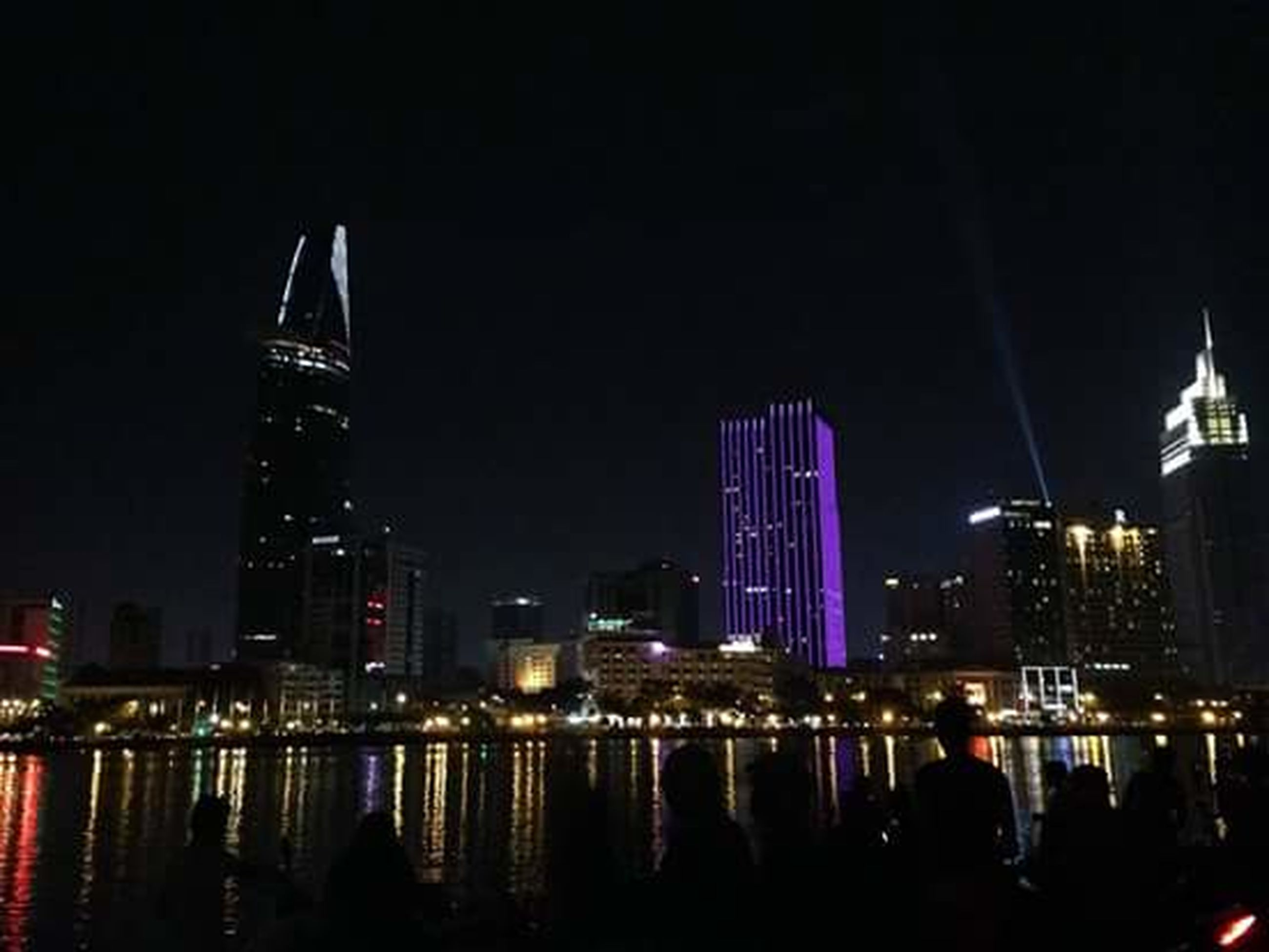 night, illuminated, city, architecture, urban skyline, cityscape, modern, skyscraper, building exterior, tower, sky, travel destinations, city life, outdoors, no people, downtown district, nightlife