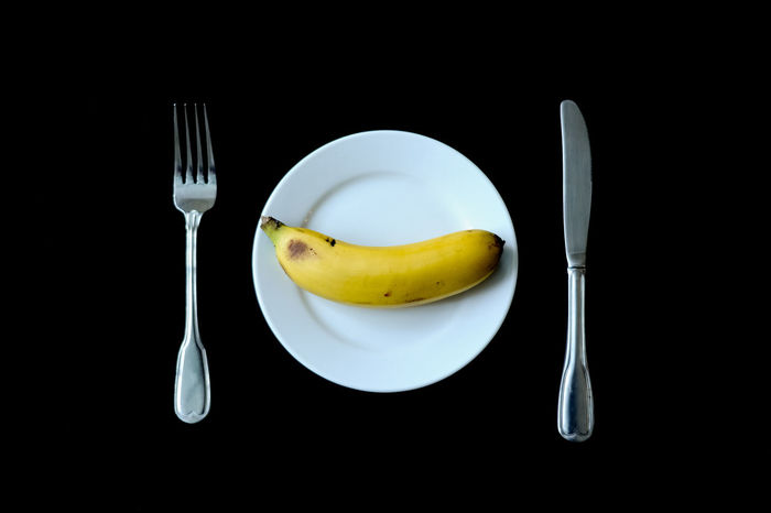 Source of Energy Banana Black Background Close-up Day Eat Healthy Energy Food Food Fork Freshness Fruit Healthy Eating Indoors  No People Plate Ready-to-eat Studio Shot Table Vegetarian Meal Daily Booster Paint The Town Yellow Food Stories