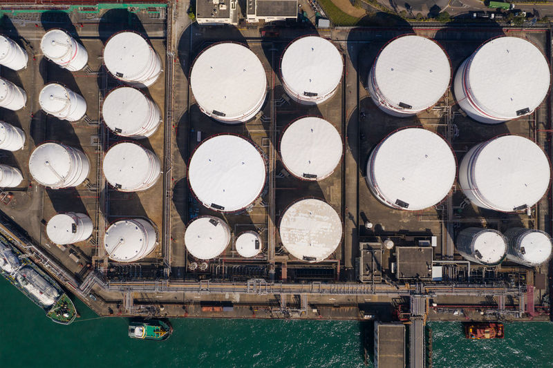 Directly above shot of oil storage tank by sea