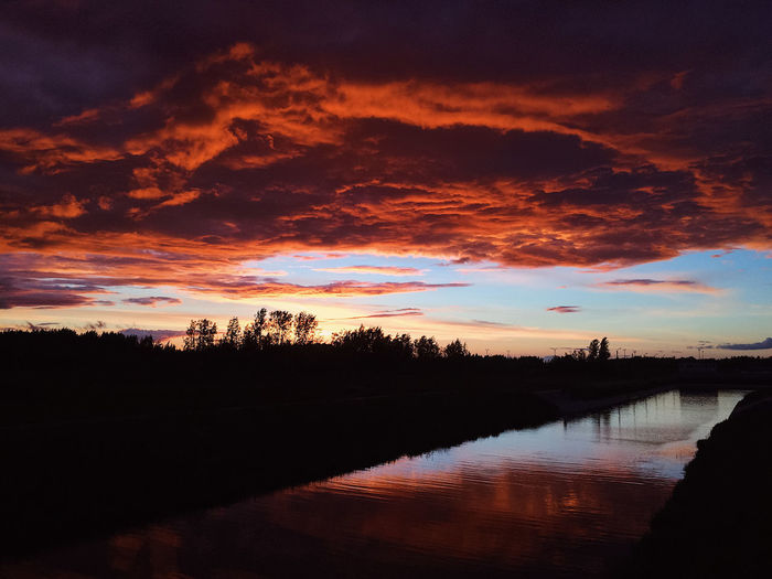 Beautiful sunset Cloud Finland Helsinki Beauty In Nature Cloud - Sky Clouds And Sky Dramatic Sky Dusk Dusk In The City Lake No People Non-urban Scene Outdoors Reflection Romantic Sky Scenics - Nature Silhouette Sky Sunset Sunsets Tranquil Scene Tranquility Water