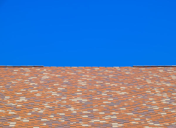 metal profile corrugated roof Architecture Brick Brick Wall Building Exterior Built Structure Clear Sky Day Low Angle View Metal Profile Corrugated Roof No People Outdoors Roof Roof Tile Sky Smoke Stack Tiled Roof