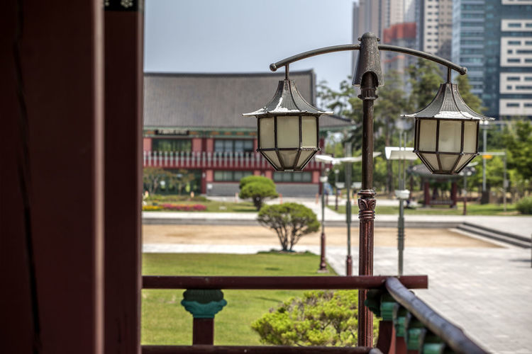Architecture Built Structure City Close-up Day Electricity Lights Focus On Foreground Green Color Growth Illuminated Korean Traditional Architecture Lighting Equipment Michuhol Park Nature No People Outdoors Plant Sky Songdo, Incheon Street Light Tranquility