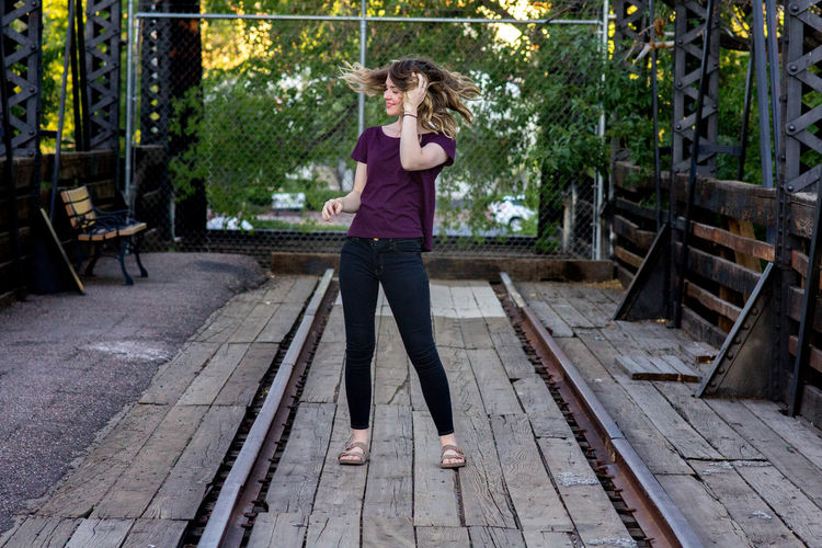 Architecture Beauty Casual Clothing Day Downtown Prescott Footpath Front View Full Length Growth Hair Flip Leisure Activity Lifestyles Long Hair Old Bridge Outdoors Paving Stone Person Portrait Prescott Railing Train Bridge Tree Wooden Bridge Young Adult Young Women
