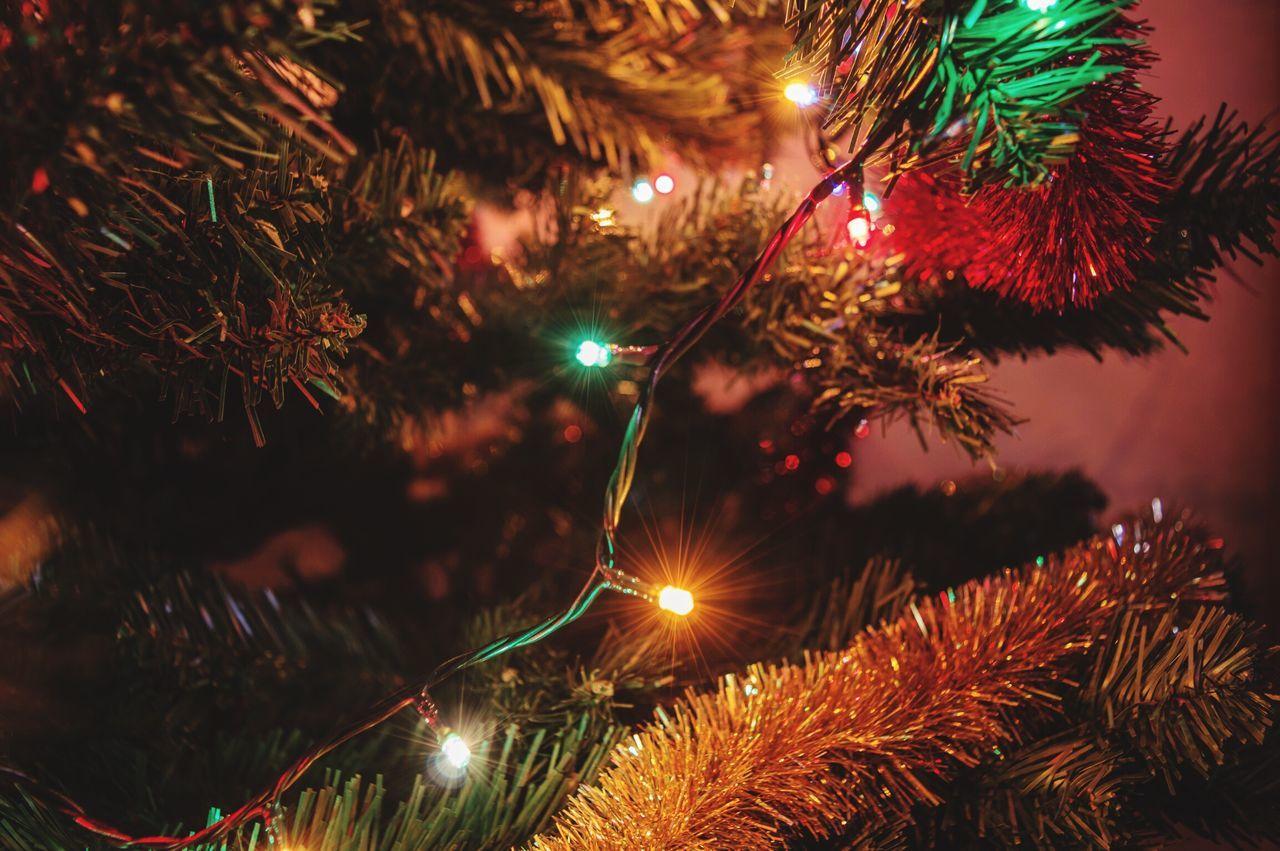 Low Angle View Of Christmas Lights At Night