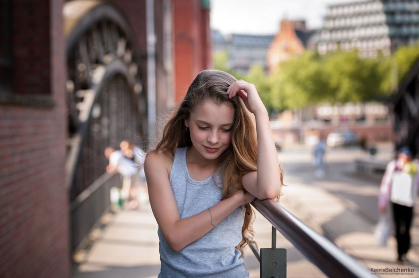 Focus On Foreground Real People Incidental People One Person Looking Down Casual Clothing Young Adult Lifestyles Bridge - Man Made Structure Outdoors Young Women Architecture Building Exterior Day City People Photo Model Best  Child City Life Long Hair Architecture Childhood Girls