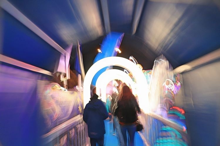 walking people blurred Architecture Blurred Motion Ceiling Group Of People Illuminated Indoors  Leisure Activity Long Exposure Motion Night People Positive Emotion Real People Rear View Women EyeEmNewHere A New Perspective On Life