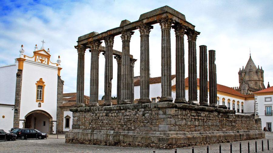 Roman temple of evora by igreja sao joao evangelista against sky