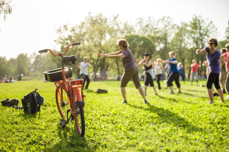 Asahi Red Bike Sunrays Day Grass Gymnastics Outdoor Gymnastic Outdoors Park People Sunset