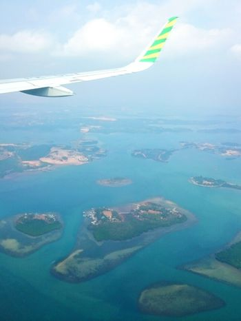 Batam Batam-Indonesia Riau Archipelago INDONESIA Nature Cloud - Sky Fog Flying Airplane Journey Mid-air Aerial View Outdoors Sea Scenics Water Sky Day Multi Colored Island Investing In Quality Of Life The Week On EyeEm