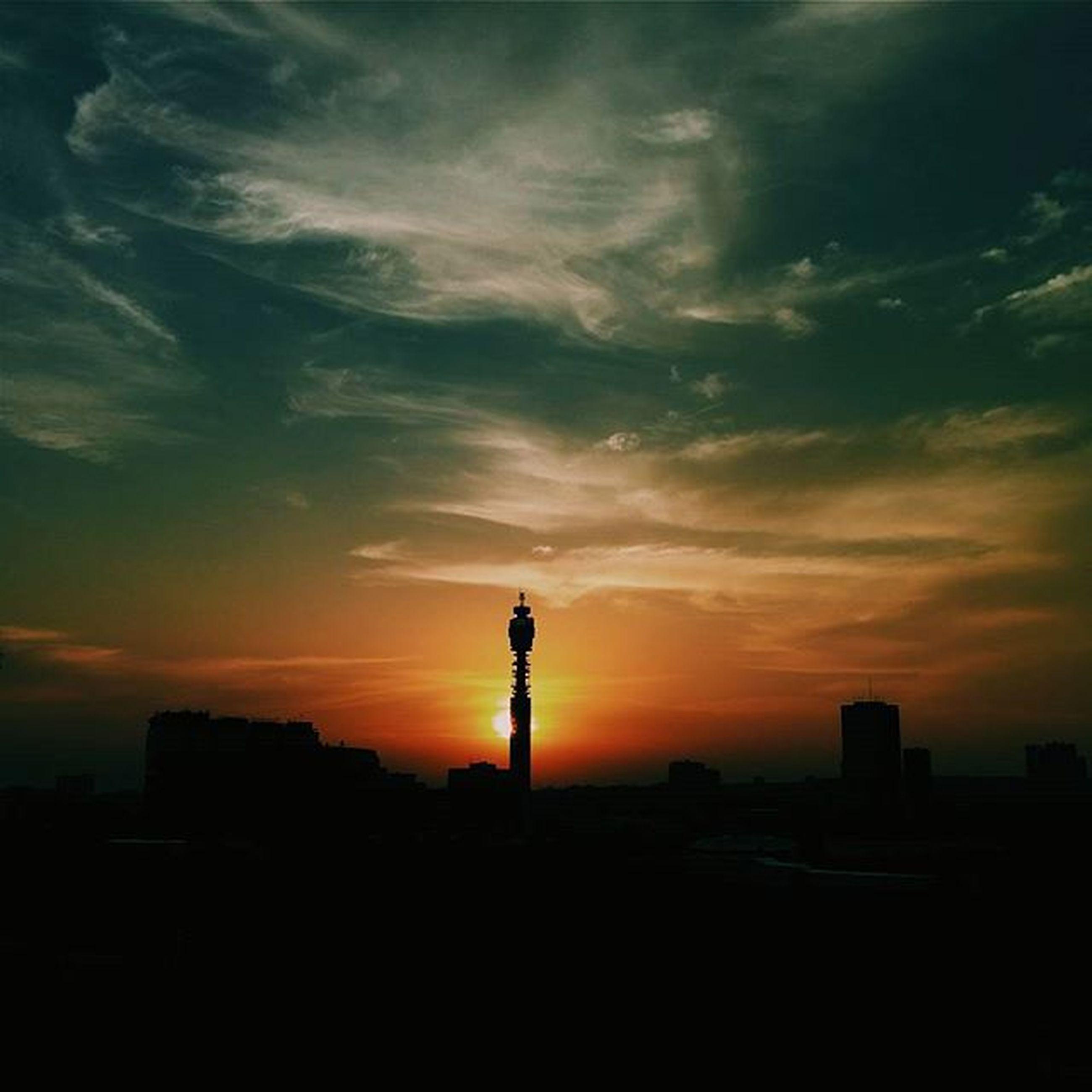 sunset, silhouette, building exterior, built structure, sky, architecture, orange color, cloud - sky, city, cloud, outline, scenics, beauty in nature, nature, outdoors, dusk, dramatic sky, cloudy, no people, building