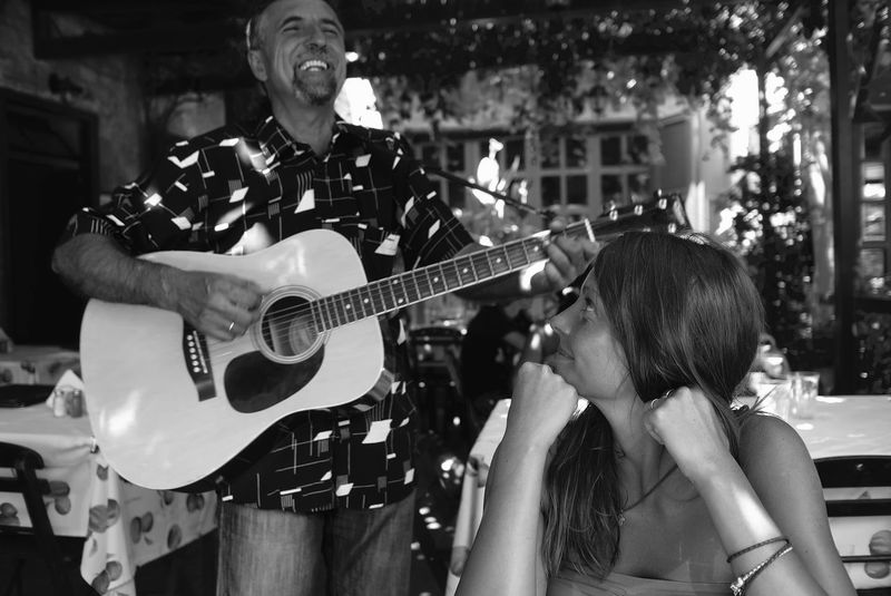 Arts Culture And Entertainment At The Restaurant Audience Blackandwhite Photography Guitar Joyful Moments Look At Him Music Musical Instrument Musician Performance Playing Smile Live For The Story