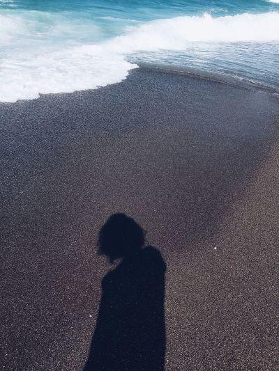 Shadow of woman on beach