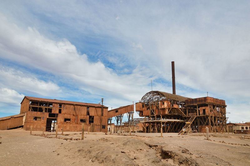 One of the many impressive abandoned buildings of the Santa Laura saltpeter plants in Northern Chile. A UNESCO World Heritage Site. EyeEm Ready   EyeEmNewHere Industrial Industry Ruins Rust UNESCO World Heritage Site Abandoned Architecture Brown Color Building Exterior Built Structure Cloud - Sky Colorful Day Deserted Empty Factory Industry No People Outdoors Run-down Rusty Saltpeter Sky