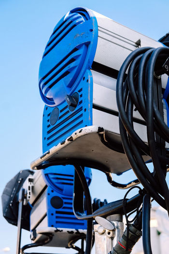 Low angle view of cables against clear blue sky