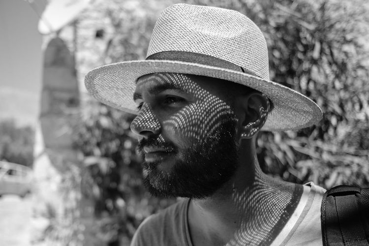 Shadow patterns on a man's face - Aegean, Greece 2018 Aegean Content Halki Hat Holiday Man Adult Beard Close-up Clothing Day Facial Hair Fashion Focus On Foreground Greece Harsh Light Hat Headshot Lifestyles Looking Looking Away Mustache One Person Portrait Real People Smiling Sombrero Sun Hat Young Adult Capture Tomorrow My Best Photo