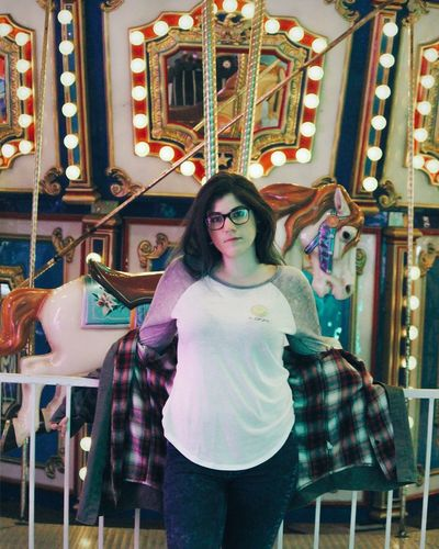 Indoors  One Person Front View Portrait Looking At Camera Standing Women Lifestyles Beautiful Woman Lights Arcade Games Arcades Fashion Casual Clothing Standing Photoshoot Canonphotography Camera Photooftheday Photography Smiling Photographer Photograph Eyeglasses  Technology