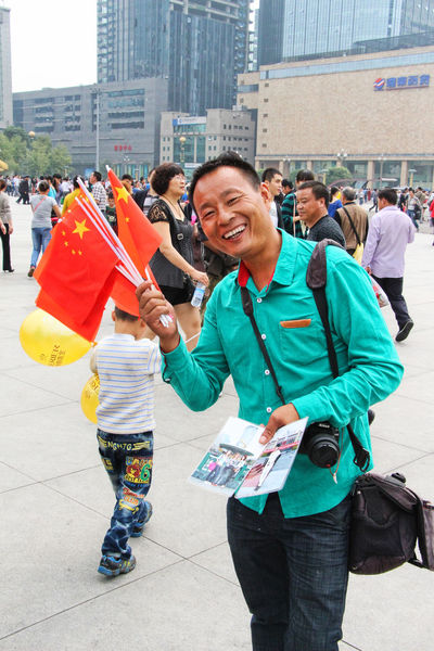 Chinese Flag National Holiday Adult Adults Only Architecture Building Exterior Cheerful Chinese City Day Holding Lifestyles Men Outdoors People Real People Smiling Togetherness Vendor Women