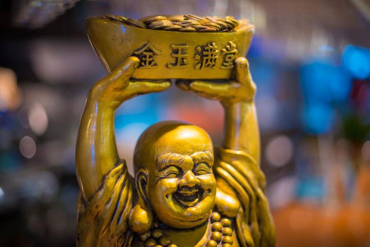 Close-up of laughing buddha statue