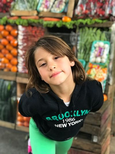 Portrait of girl standing at market