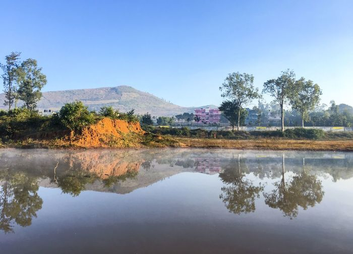 Beautiful Scene captured With Iphone 6s #reflections Reflection Tree Plant Water Lake Sky Tranquility Scenics - Nature Nature Tranquil Scene Waterfront Beauty In Nature Day No People Mountain Clear Sky Outdoors Growth Non-urban Scene
