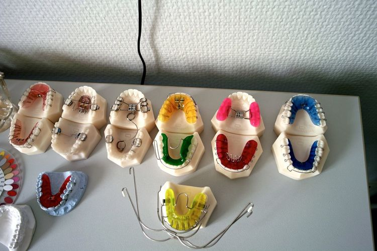 High angle view of multi colored dental equipment on table