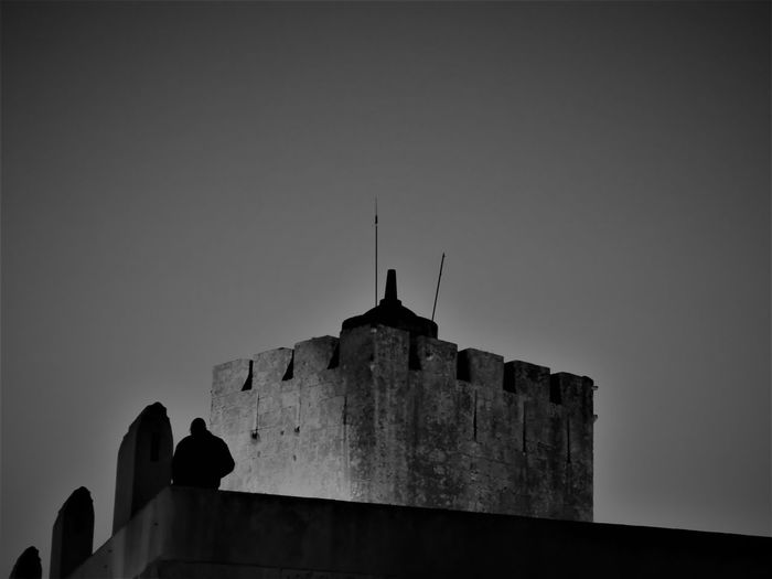Castle Silhouette Silhouettes Walking Around Ancient Architecture Antenna Antenna - Aerial Architecture Building Exterior Built Structure Castle Ruin Castle Tower Castle Walls Clear Sky Copy Space Day Low Angle View Night Outdoors Selective Focus Simplicity Sky Top Of The Tower Tower Unrecognizable Person Your Ticket To Europe Breathing Space Investing In Quality Of Life The Week On EyeEm
