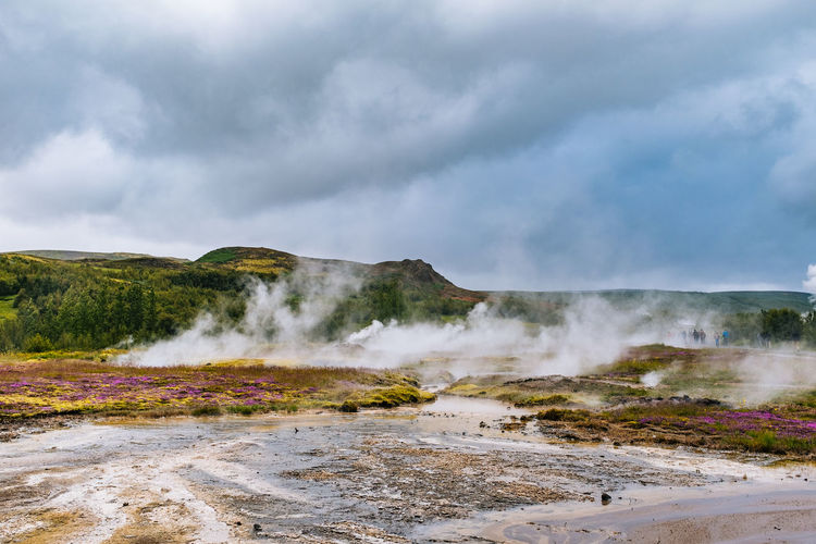Beauty In Nature Cloud - Sky Day Erupting Geyser Heat - Temperature Hot Spring Iceland Landscape Motion Natural Phenomenon Nature No People Outdoors Physical Geography Power In Nature Scenics Sky Smoke - Physical Structure Steam Travel Destinations Volcanic Landscape Water