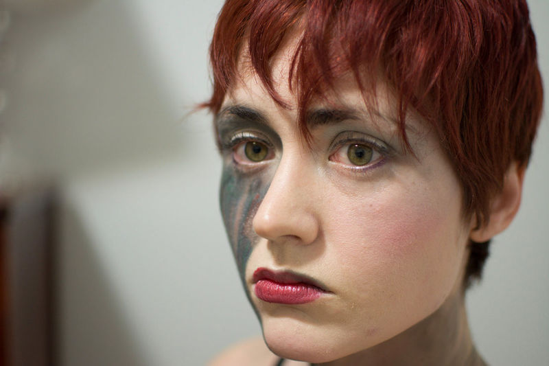 Close-up portrait of woman with face paint