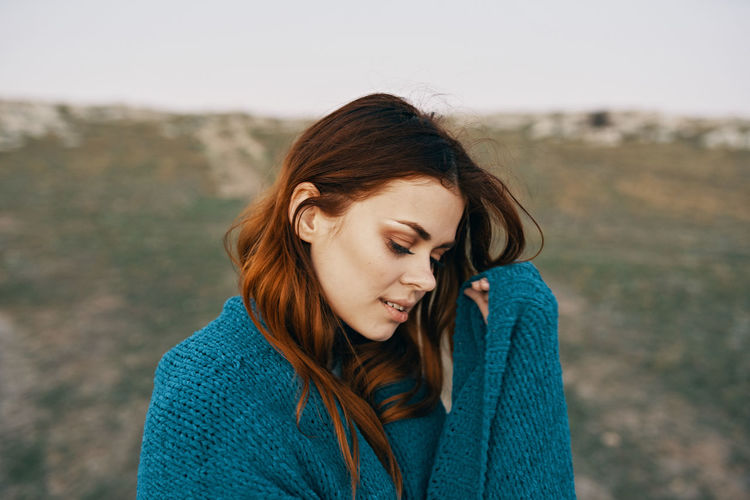 Beautiful young woman looking down