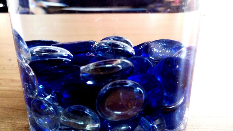Close-up of blue glasses on table