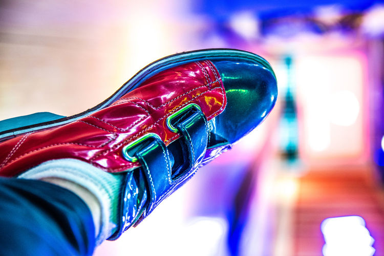 Fancy bowling shoes. Bowling Bowling Balls Bowling Alley Game Games Close-up Selective Focus Indoors  Focus On Foreground Blue Multi Colored No People Sport Red Shiny Boxing - Sport Paint Still Life Lifestyles Art And Craft Day Body Part Colourful Colors