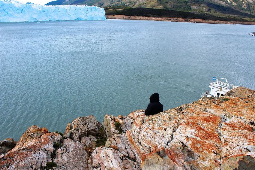 Argentina Beauty In Nature Blue Day El Calafate Full Length Idyllic Leisure Activity Lifestyles Mountain Nature Non-urban Scene Outdoors Patagonia Perito Moreno. Patagonia. Argentina. Remote Rock Rock - Object Rock Formation Scenics Standing Tranquil Scene Tranquility Unrecognizable Person Water
