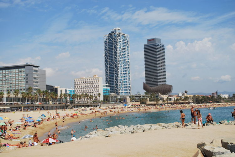 Adult Adults Only Architecture Barcelona Barcelona, Spain Beach Building Exterior City Cloud - Sky Crowd Day Large Group Of People Leisure Activity Outdoors People Relaxation Sand Sea Sky Skyscraper Summer Travel Destinations Urban Skyline Vacations Water