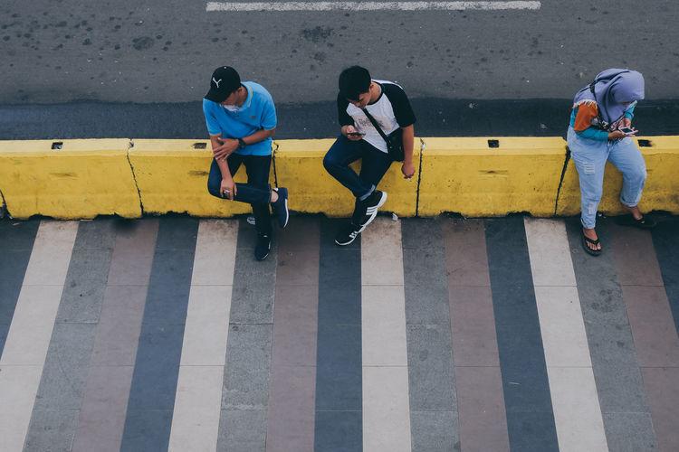 Men on zebra crossing