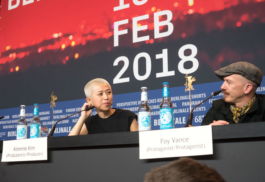 Berlin, Germany - February 23, 2018: Producer Kimmie Kim and Irish musician and singer-songwriter Foy Vance attend the 'Songwriter' press conference at 68th Berlinale 2018 Famous Film Festival Interview Premiere Press The Media Berlinale Berlinale 2018 Berlinale Festival Berlinale2018 Berlinale68 Documentary Film Festival Film Industry Foy Vance Frontal View Kimmie Kim Mass Media Musician People Press Conference Producer Sitting Songwriter Two People