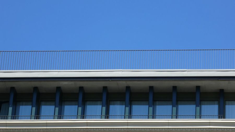 Just blue Blue Architecture Day Built Structure No People Outdoors Sky EyeEm Gallery Part Of A Building Blue Color Low Angle View Minimalism In A Row Metal Fence Windows Blue Sky Skyview Lines And Patterns The Graphic City