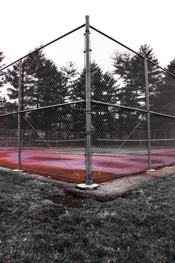 Fence Playing Field Sport Chainlink Fence Playground Outdoors Sky Court Tenniscourt Tree No People Day Metal Angles And Lines Tennis 🎾