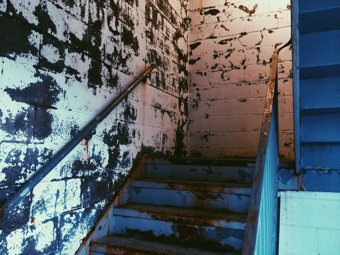 Abandoned staircase against building
