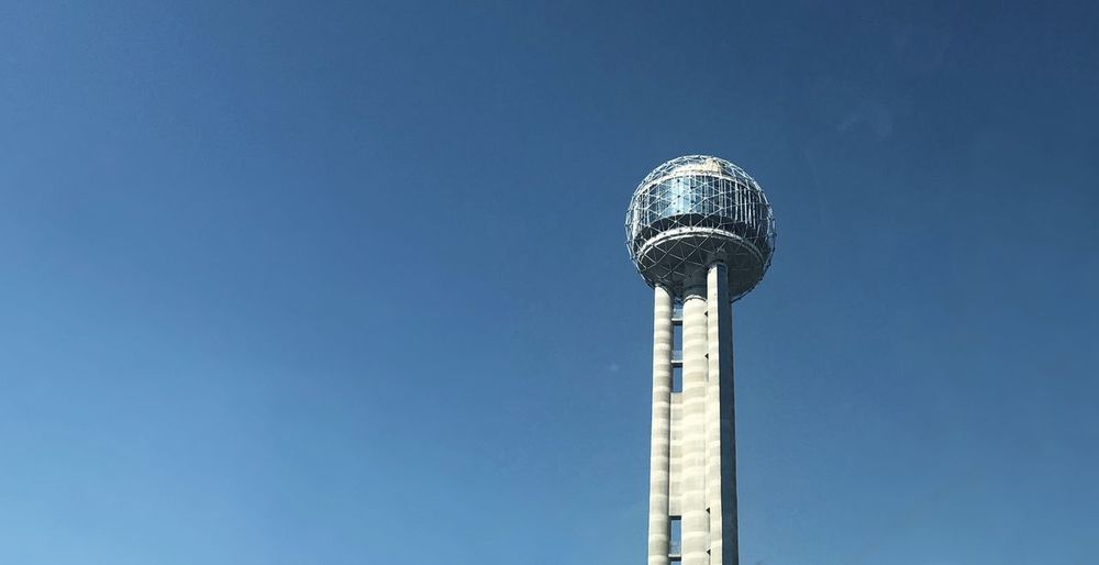 Low angle view of reunion tower and building against clear sky in dallas, tx