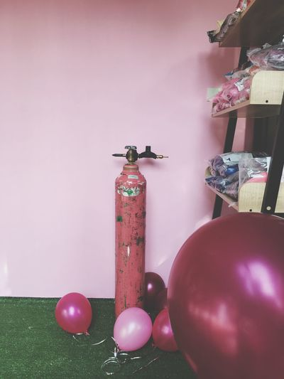 Balloons and air pump against wall