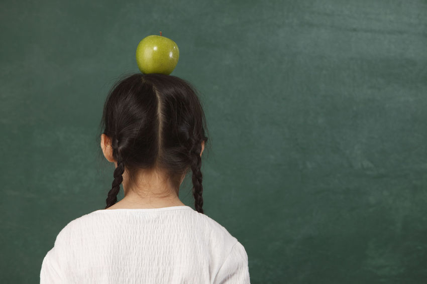 little girl with green apple on her head Apple - Fruit Balance Blackboard  Chinese Day Education Food Stories Fruit Headshot Indoors  Infront One Person People Real People Rear View Standing