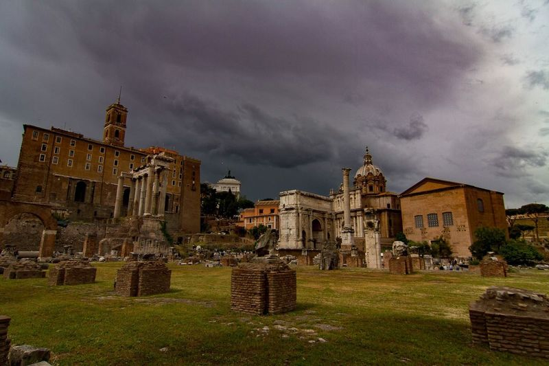 Roman ruins against cloudy sky