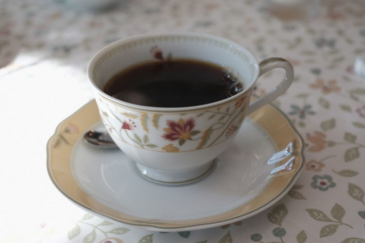 Close-up of tea cup on table