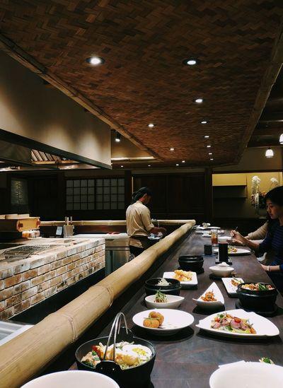 Japanese style restaurant Light And Shadow Dimmed Dim Light Dark Restaurant Japanese Style Eating Luxury Food And Drink Temptation Prepared Food Sushi Japanese Food Chopsticks Salmon Sashimi  Indulgence