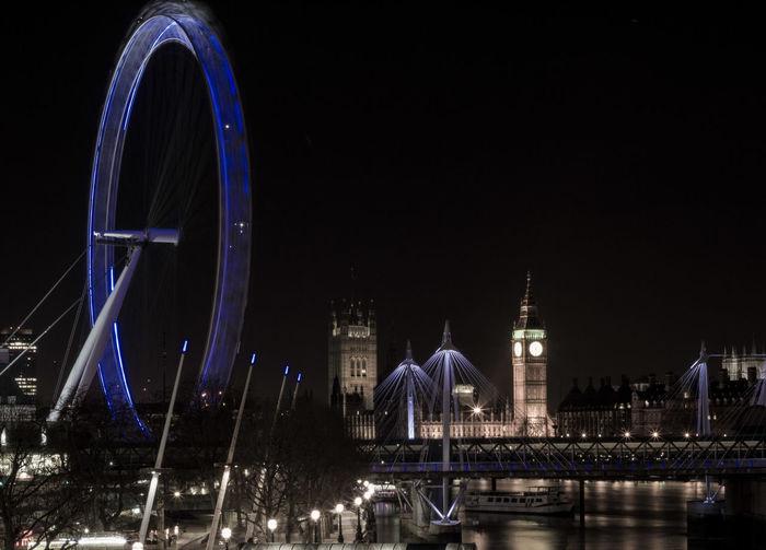 Golden Jubilee Bridge Over Thames River With Illuminated London Eye