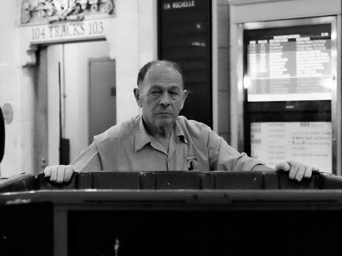 Pushing a wagon in Grand Central Terminal, New York. USA New York Grand Central Terminal Train Station Worker Street Photography X100r Fujifilm