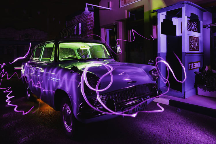 direct angle of view painting with light on an antique car. Architecture Building Exterior Built Structure Car City Garage Headlight Illuminated Land Vehicle Lighting Equipment Luxury Mode Of Transportation Motor Vehicle Night Nightlife No People Outdoors Pink Color Purple Stationary Street Transportation Vintage Car
