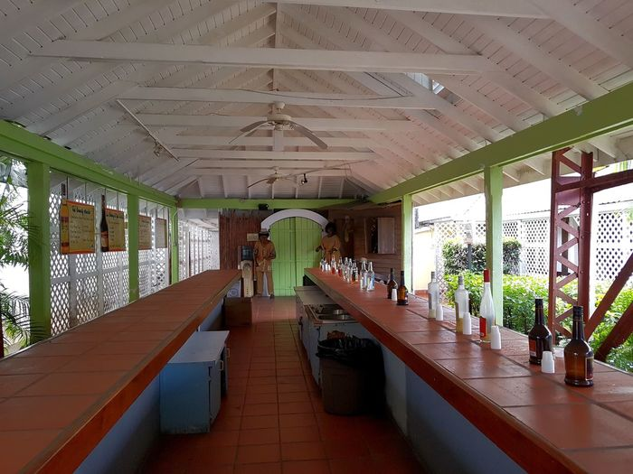 Rum Tasting Room in a Rum Factory. The strongest had 84% 😱😉. ... Tasting Rum Rum Tasting Room Rum Factory Caribbean Bottle Caribbean Island Houses Colourful Island Life Modern Luxury Ceiling Architecture Hallway Flooring Tiled Floor