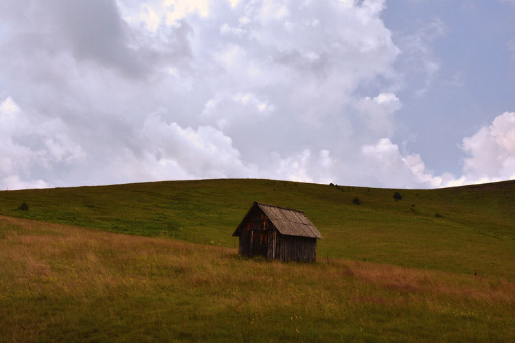 A house on the hill Serbia Serbian Photos Beauty In Nature Cloud - Sky Day Environment Field Grass Horizon Over Land Landscape Nature No People Outdoors Plain Scenics - Nature Serbian_beauties Serbianature Sky Tranquil Scene Tranquility The Great Outdoors - 2018 EyeEm Awards